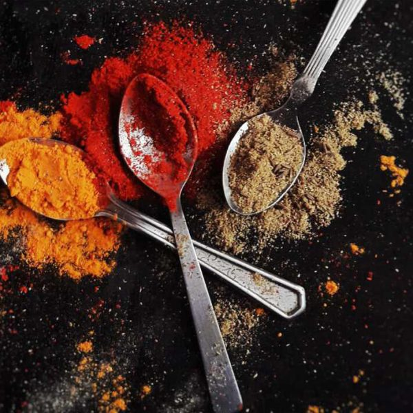 Spoons with spices on table